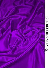 Luxurious deep purple satin/silk folded fabric, useful for backgrounds