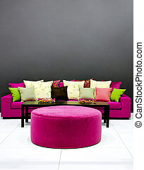 Purple settee - Purple sofa with pillows in dark room