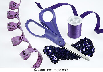 Purple Sewing Supplies - Purple sewing tools on white...