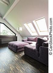Purple sofa in attic lounge room