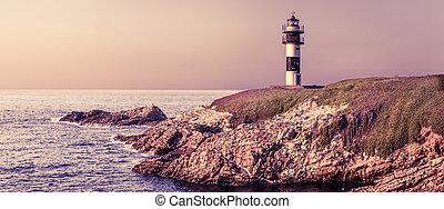 Purple sunset in Faro Isla Pancha, Pancha Isle lighthouse , Ribadeo, Spain