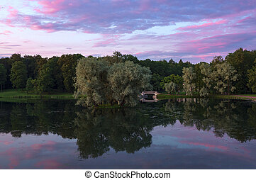 Purple sunset on the lake in the Park. Gatchina