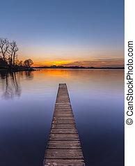 Purple Sunset over Serene Lake vertical
