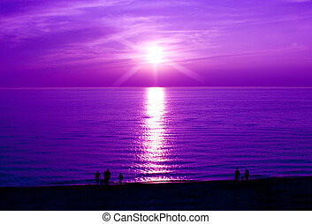 Purple Sunset - People watching a beautiful sunset at the...