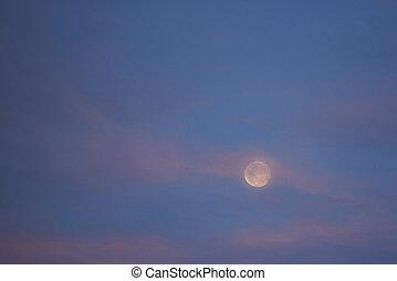 Purple sunset sky with full moon