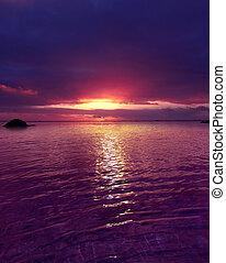 Purple Sunset over smooth ripples