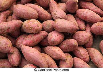Purple sweet potato stacked together in a market