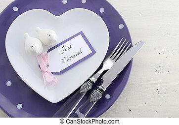 Purple theme wedding table place setting.