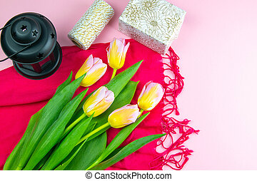 Purple tulips and gift boxes over pinc table. Top view with copy space