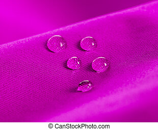 Purple waterproof fabric with waterdrops close up