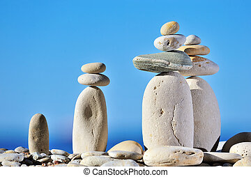 White long pebbles on a background of blue sky