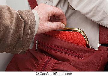 Purse stealing closeup - A close up of a man stealing a red...