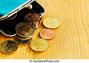 purse with coins. debt and poverty - coins and an empty...