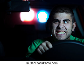 Police in pursuit of a man in the car. Selected focus on face