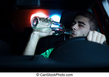 Police in pursuit of a man who is drinking in the car. Selected focus on face