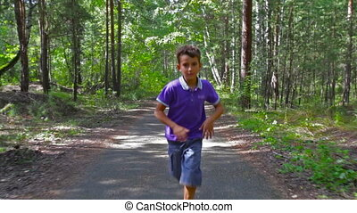 Pursuit - Serious lad running through the forest as if...