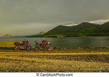 Purwakarta, West Java, Indonesia (03/30/2018) : The rider is touring with his motorcycle through the Jatiluhur Dam side which is commonly called Parang Gombong