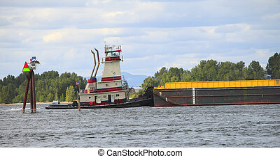 A push boat pushing a barge on the Columbia river Portland OR.
