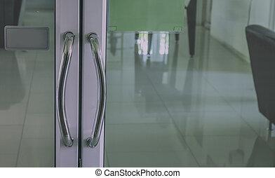 Push glass door office morning