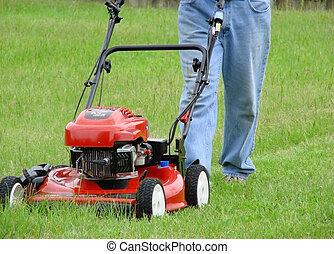 Push Lawnmower - Man mowing yard with red push lawnmower