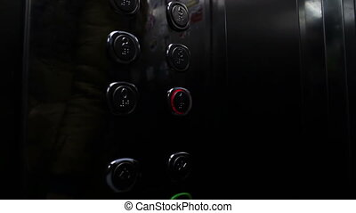 Push on the Button In the Elevator - People inside the...