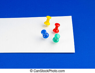Push pins on white paper. - Four push pin on an white piece...