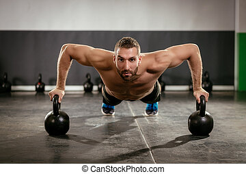 Push-Up - Young muscular man doing push-up exercise with...