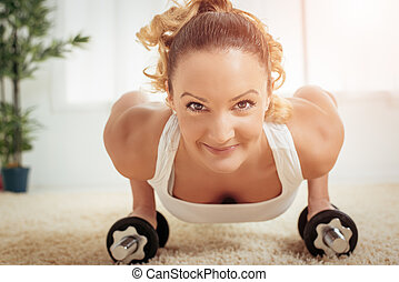 Push-Up - Beautiful young muscular woman doing push-up eat...