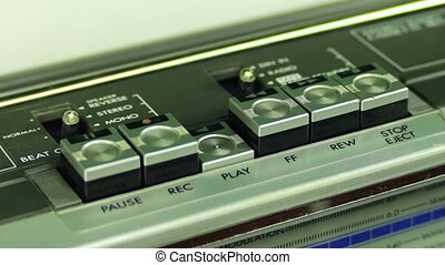 Pushing Button on the Audio Cassette Player - Man finger...