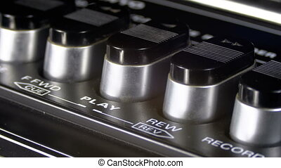 Pushing Buttons on a Tape Recorder, Play, Stop, Rec, ff,...