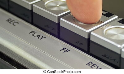 Pushing Forward Button on a Vintage Tape Recorder