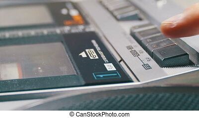 Pushing Play and Stop Button on the Vintage Tape Recorder