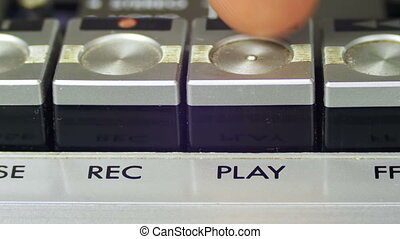 Pushing Play Button on a Vintage Tape Recorder