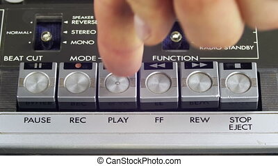 Pushing Play, Stop and Record Button on a Vintage Tape Recorder