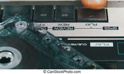 Pushing Play, Stop, Rewind and Forward Button on the Vintage Audio Cassette Player