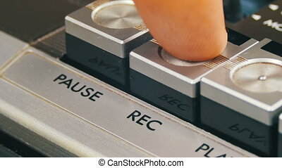 Pushing Record Button on a Vintage Tape Recorder