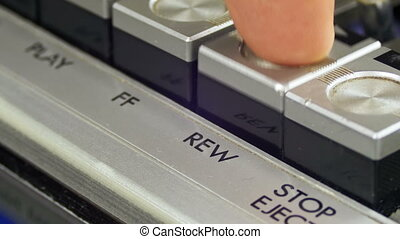 Pushing Rewind Button on a Vintage Tape Recorder. Close-up....