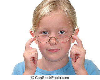 Pushing Up Glasses - Nine year old blonde girl with bright...