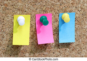 Pushpin - Close up from colorful blank post it note affixed...