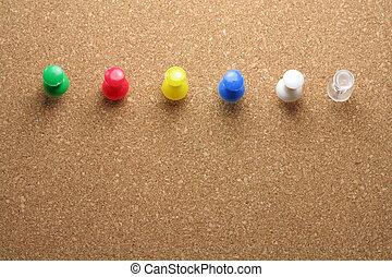 pushpins , corkboard