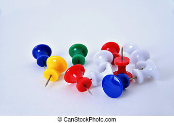 pushpins on a white background macro
