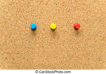 Pushpins on Cork board as texture background