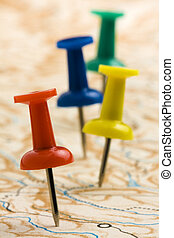 Pushpins on nameless geographic map