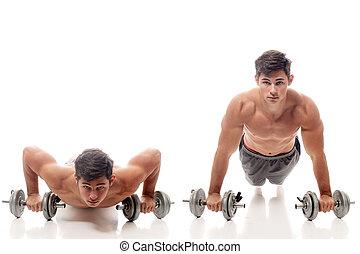 Pushup exercise - Young man doing pushups. Studio shot over...