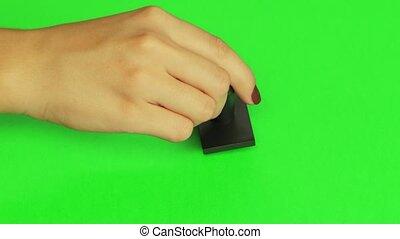 Put a stamp. Close up. Green screen