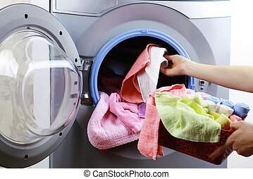 put cloth in washer - Preparing the laundry from the basket...
