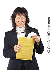 Put dvd disc on the envelope - Businesswoman put dvd disc on...
