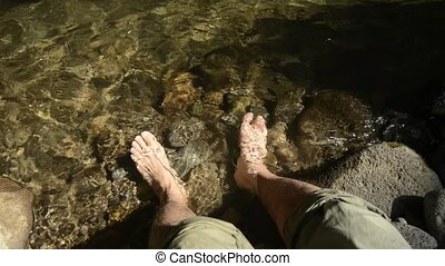 Put feet in brook - Put man of both feet in shimmering brook...