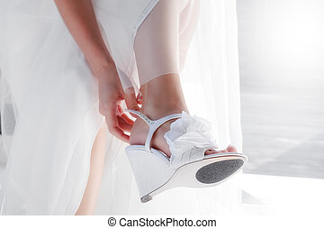 put on - close up view of woman putting  some shoe on