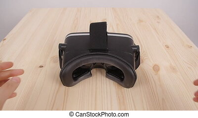 Put on virtual reality glasses from the first person